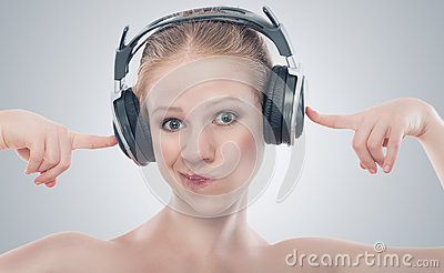Funny girl listening to music on headphones