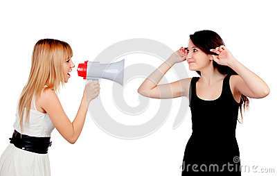Funny girl with a megaphone talking to her friend