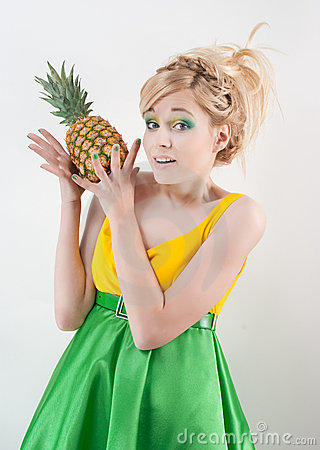 Funny girl with pineapple