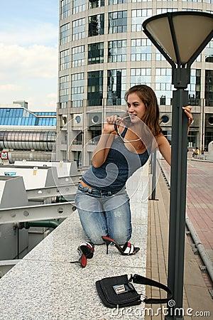 Free Funny Girl Sitting On Railing Royalty Free Stock Photos - 10350748