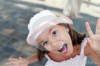 Funny girl in sunhat