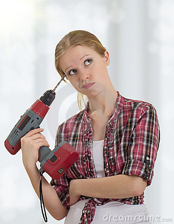 Free Funny   Girl With A Drill Drills Head Royalty Free Stock Photography - 23196387
