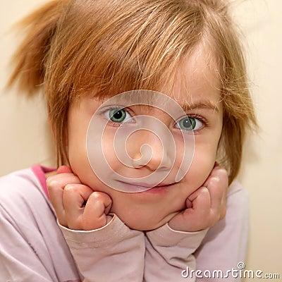 Funny green-eyed little girl