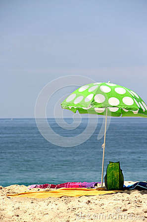 Funny green sun ubrella on the beach