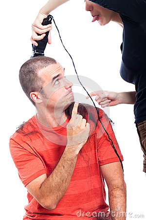 Funny hairdresser shaving man hair