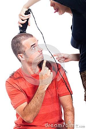 Funny hairdresser shaving man hair