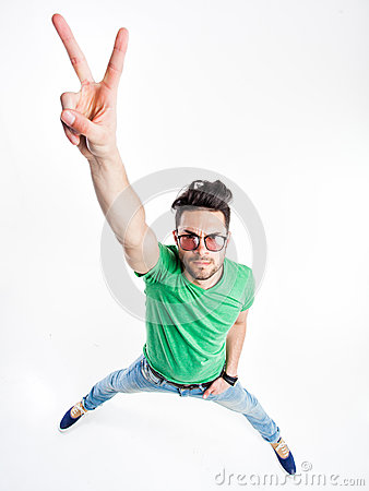 Free Funny Handsome Man With Hipster Glasses Showing Victory Looking Angry Royalty Free Stock Images - 30668709