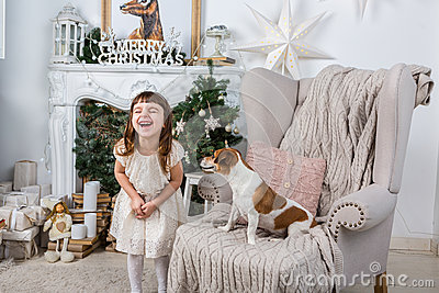 Funny happy girl and dog Stock Photo
