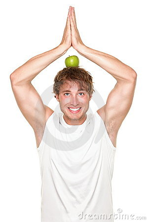 Funny healthy yoga fitness man eating