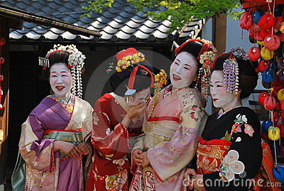 Funny henshin. Laughing Geishas spotted in Kyoto. Editorial Image