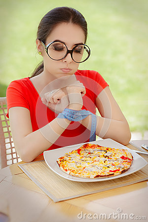 Free Funny Hungry Woman With Hands Tied With Measure Tape Stock Image - 51427381