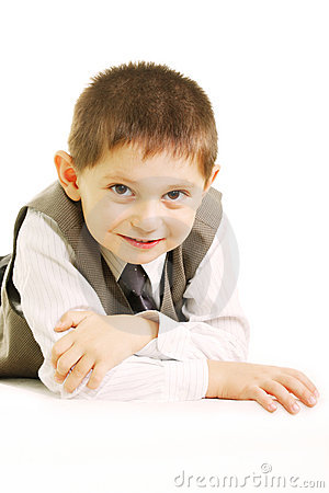 Free Funny Kid Laying Against White Stock Image - 11414311