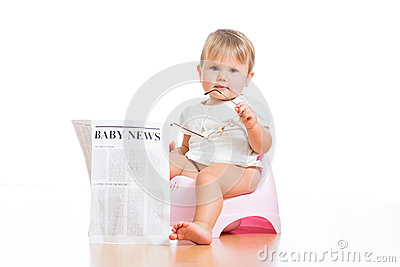 Funny kid sitting on chamberpot with newspaper