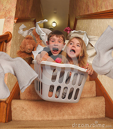 Free Funny Kids Riding In Laundry Basket Downstairs Royalty Free Stock Image - 59174656