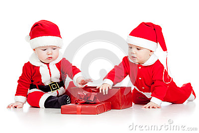 Funny kids in Santa Claus clothes with gift box