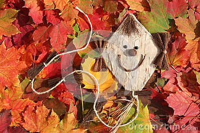 Funny kite and autumn leaves