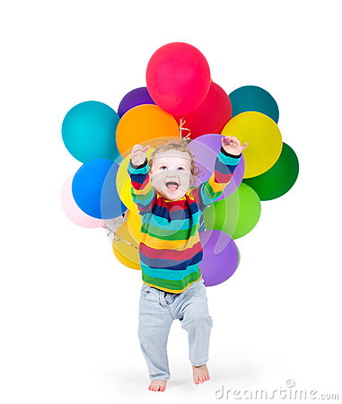 Funny laughing baby playing with party balloons