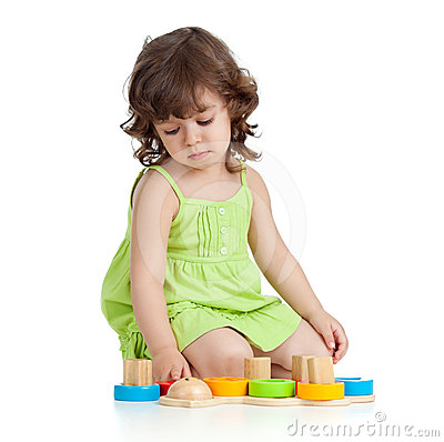 Funny little child playing with colourful toys