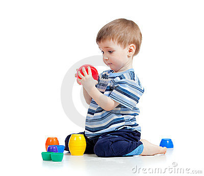 Funny little child playing with cup toys