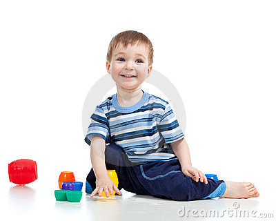 Funny little child is playing with cup toys