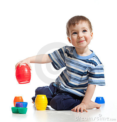 Funny little child is playing with toys