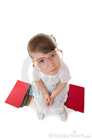 Funny little girl with books