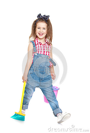 Funny Little Girl In Denim Overalls Sweeping The Stock