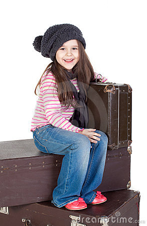 Funny little girl with the old suitcases
