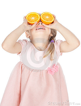 Funny little girl with oranges over white