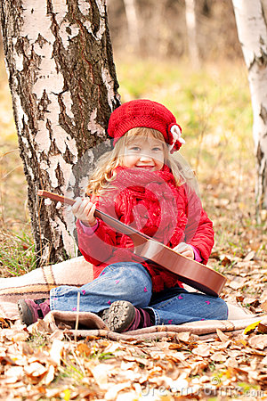 Funny little girl playing guitar