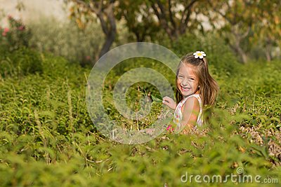 Funny little girl running in the park