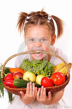 Funny little girl with vegetables and fruits
