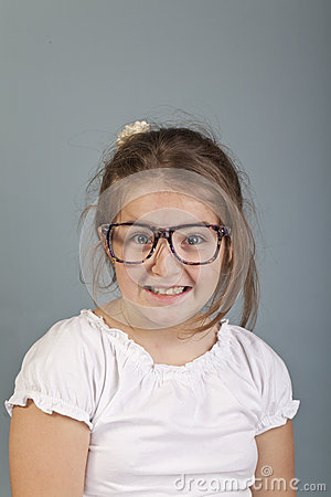 Funny look of a girl with glasses