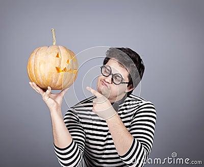 Funny mad men kepping pumpkin.