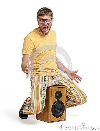 Funny man dancing on the speaker