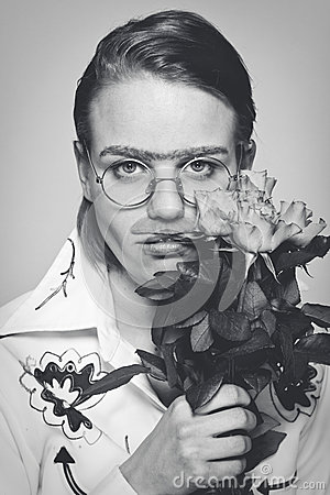 Funny man with flowers. old-time picture