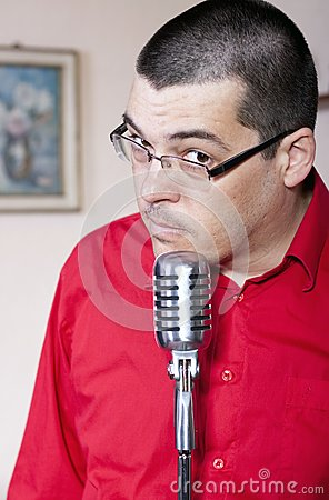 Funny man with old microphone