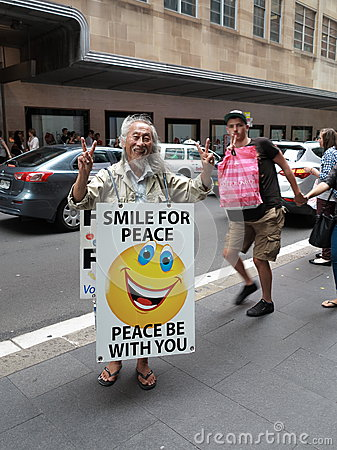 Funny man with peace sign Editorial Stock Image