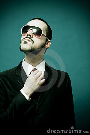 Funny Man In Suit Fixing Tie Royalty Free Stock Photos - Image: 2509218