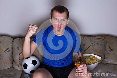 Funny man watching football on tv