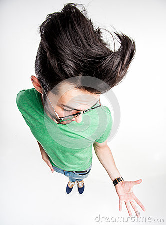 Funny man with wierd hairstyle showing his palm - wide angle
