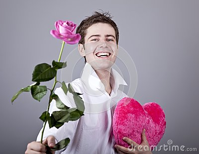 Funny men with rose and toy heart.