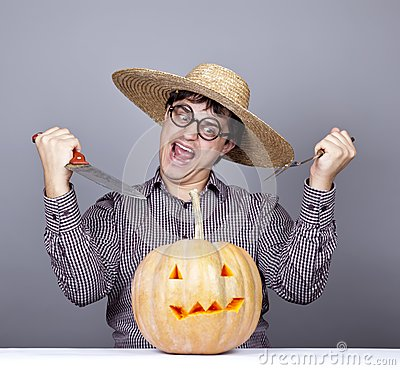 Funny men try to eat a pumpkin.