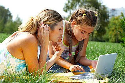 Funny mom and daughter with laptop