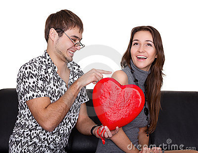 Funny nerd guy gives a valentine glamorous girl