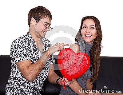 Funny nerd guy gives a valentine glamorous girl