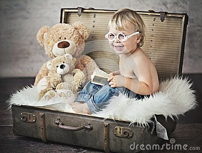 A funny picture of little boy in suitcase