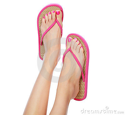 Funny pink sandals on female feet