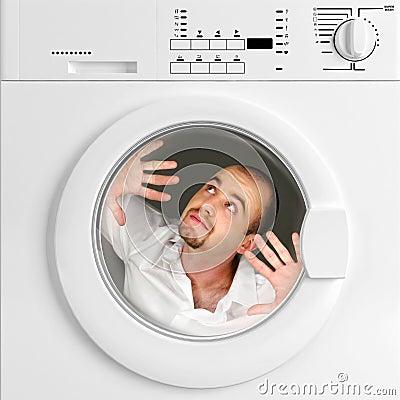 Funny portrait of man inside washing machine
