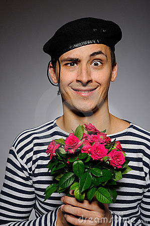 Funny romantic sailor man holding rose